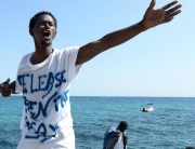A man shouts as he stands on the rocks facing the sea, in Ventimiglia, at the border between Italy and France, Sunday, June 14, 2015. French border police blocked border crossings last week, citing the influx of migrants, and about 200 would-be refugees have refused to leave the rocks of Ventimiglia, just a few kilometers from the swank resorts of Nice and Saint-Jean-Cap-Ferrat on the French Riviera. (ANSA/AP Photo/Massimo Pinca)