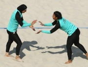 Egypt's Doaa Elghobashy (L) and Nada Meawad celebrate after winning a point during the women's beach volleyball qualifying match between Italy and Egypt at the Beach Volley Arena in Rio de Janeiro on August 9, 2016, for the Rio 2016 Olympic Games. / AFP PHOTO / Yasuyoshi Chiba