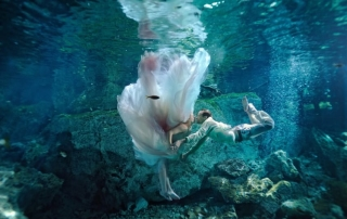 PIC BY PIERRE VISUAL STUDIO / CATERS NEWS - (PICTURED: A trash the dress session in an Playa Del Carmen, Mexico) - A talented photographer has captured newlyweds taking the plunge into married life with mesmerising underwater trash the dress photos. Pierre Violle has been snapping newlyweds underwater in stunning cenotes and caves in Mexico since 2009. Couples travel across the world to spend a day with the photographer in idyllic locations to celebrate their nuptials. The French native started out as a photojournalist in Europe and Latin America before moving to Mexico in 2006. After falling in love with scuba diving, he decided to marry his skills as a photographer and a diver to offer his unique wedding service: Pierre Visual Studio. SEE CATERS COPY