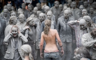 epaselect epa06067623 Prostestors dressed in grey clothes like Zombies attend a arts performance called '1000 Gestalten' demonstration prior the upcoming G20 summit in Hamburg, northern Germany, 05 July 2017. The G20 Summit (or G-20 or Group of Twenty) is an international forum for governments from 20 major economies. The summit is taking place in Hamburg 07 to 08 July 2017.  EPA/LUKAS BARTH-TUTTAS